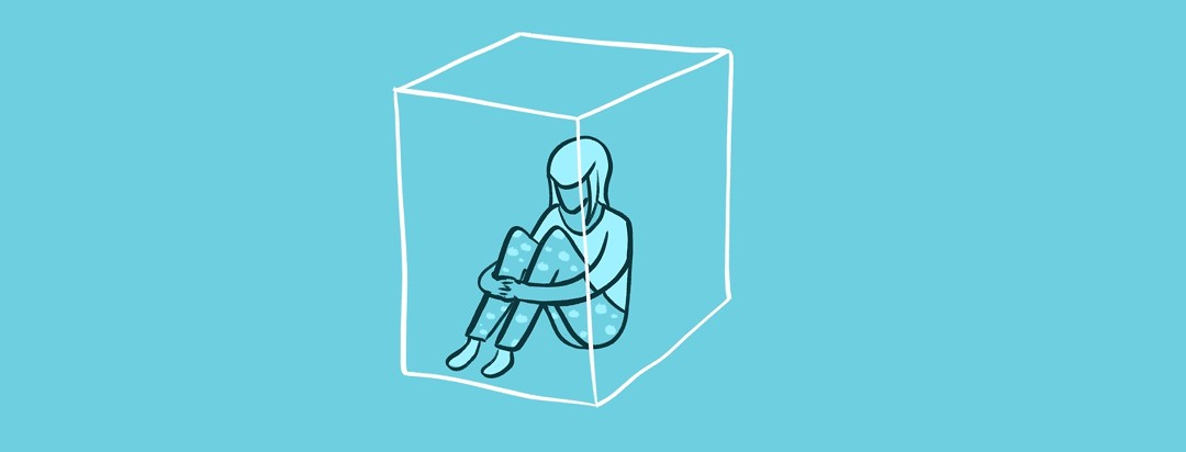 woman in pajamas trapped in cube