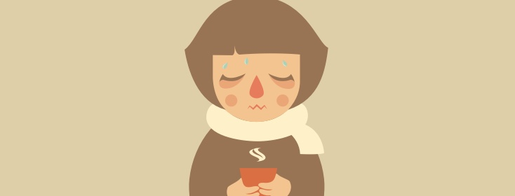 woman with cold sipping tea