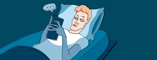 person texting in bed
