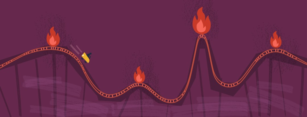 a roller coaster with fires on it
