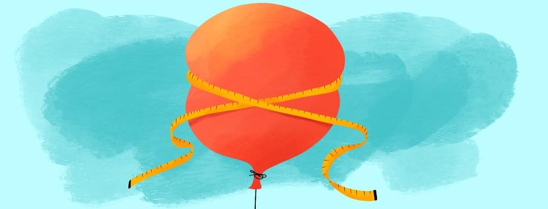 ballon with tight measuring tape around it