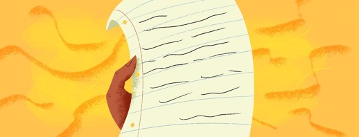 hand holding a written letter