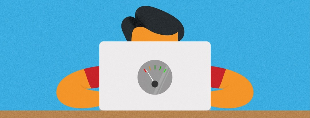 man sitting at a laptop with a gas gauge on it on empty