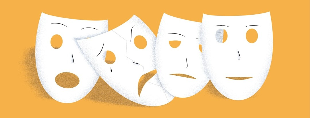 Masks depicting different emotions that represent the stages of grieving