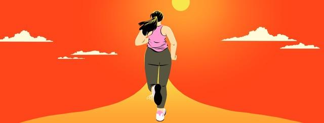 A woman is running along a path heading toward the sun