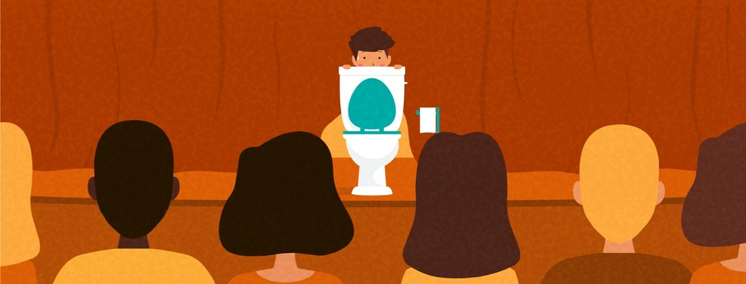 a person embarrassed hiding behind a toilet on a stage