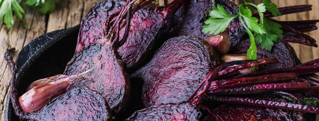Roasted beets placed in a cast iron skillet.