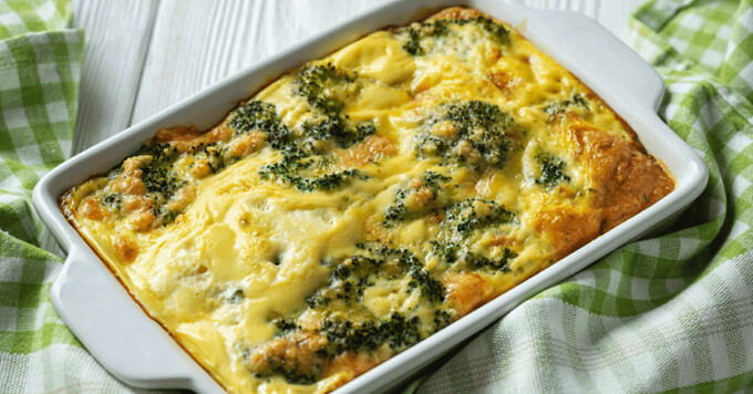 Egg bake with broccoli and cheese in a white casserole dish
