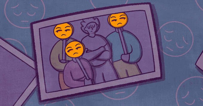 A dull family photo where the person in the middle is isolated from the family members around them. The family is holding judgemental emoji face signs over their face.