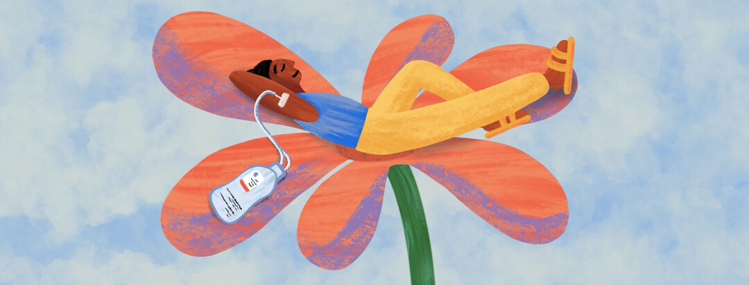 Person comfortably laying on a flower with an IV infusion treatment connected to their arm
